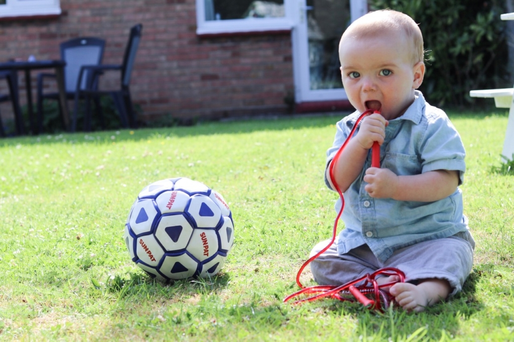 cute baby with skipping rope