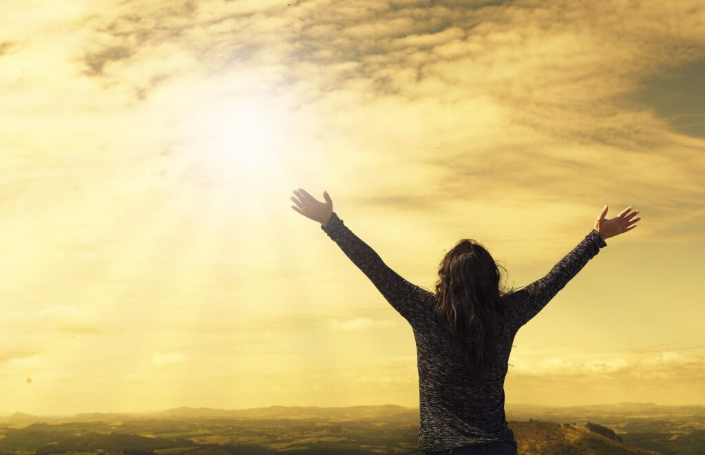 Woman with arms to sun - Objective Prayer Exercise