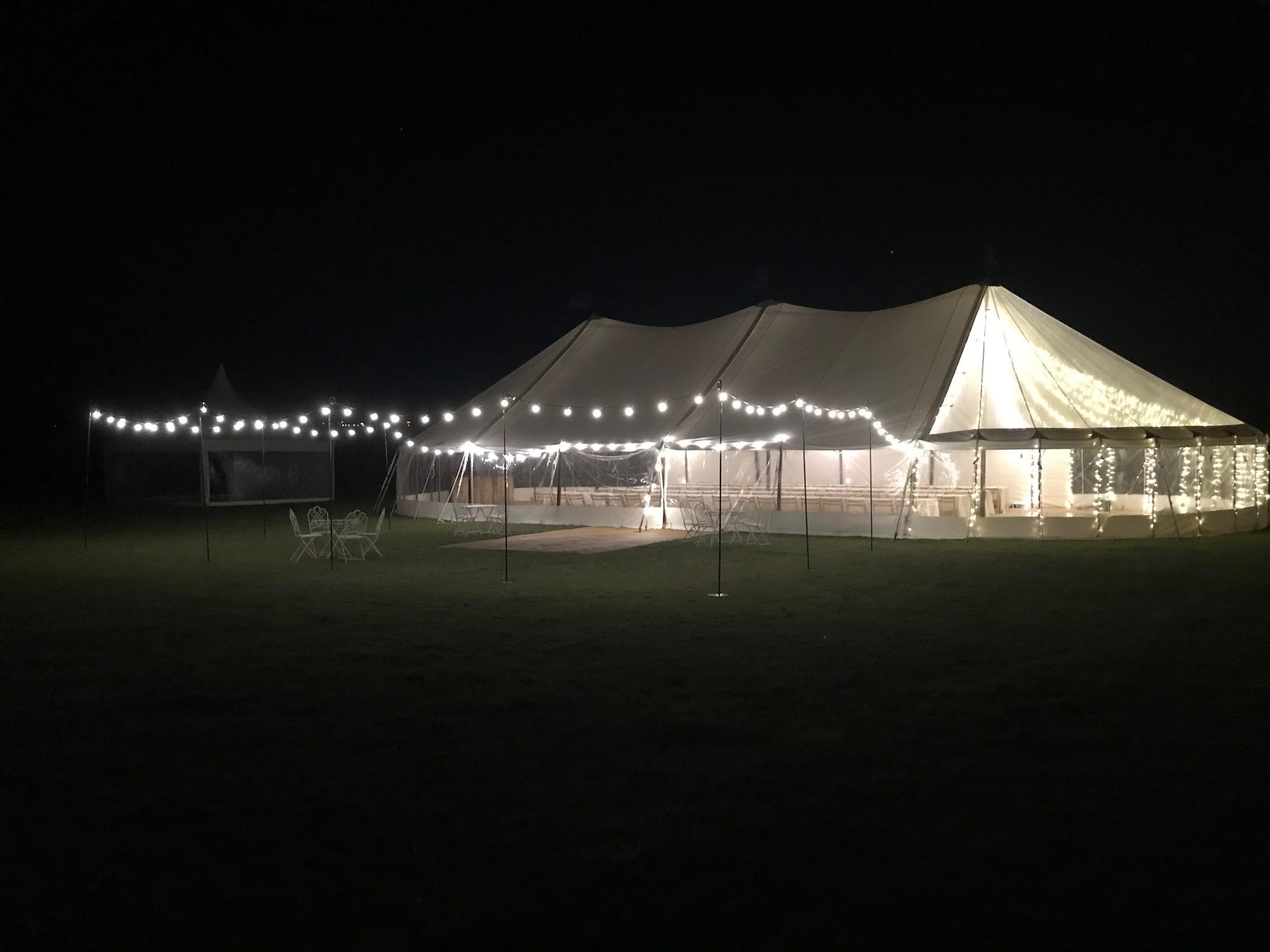 County Marquees East Anglia Sail Cloth Marquee Hire with Festoon Lighting at night