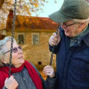 Elderly couple spending time together outside. Discussing the CARES Act.