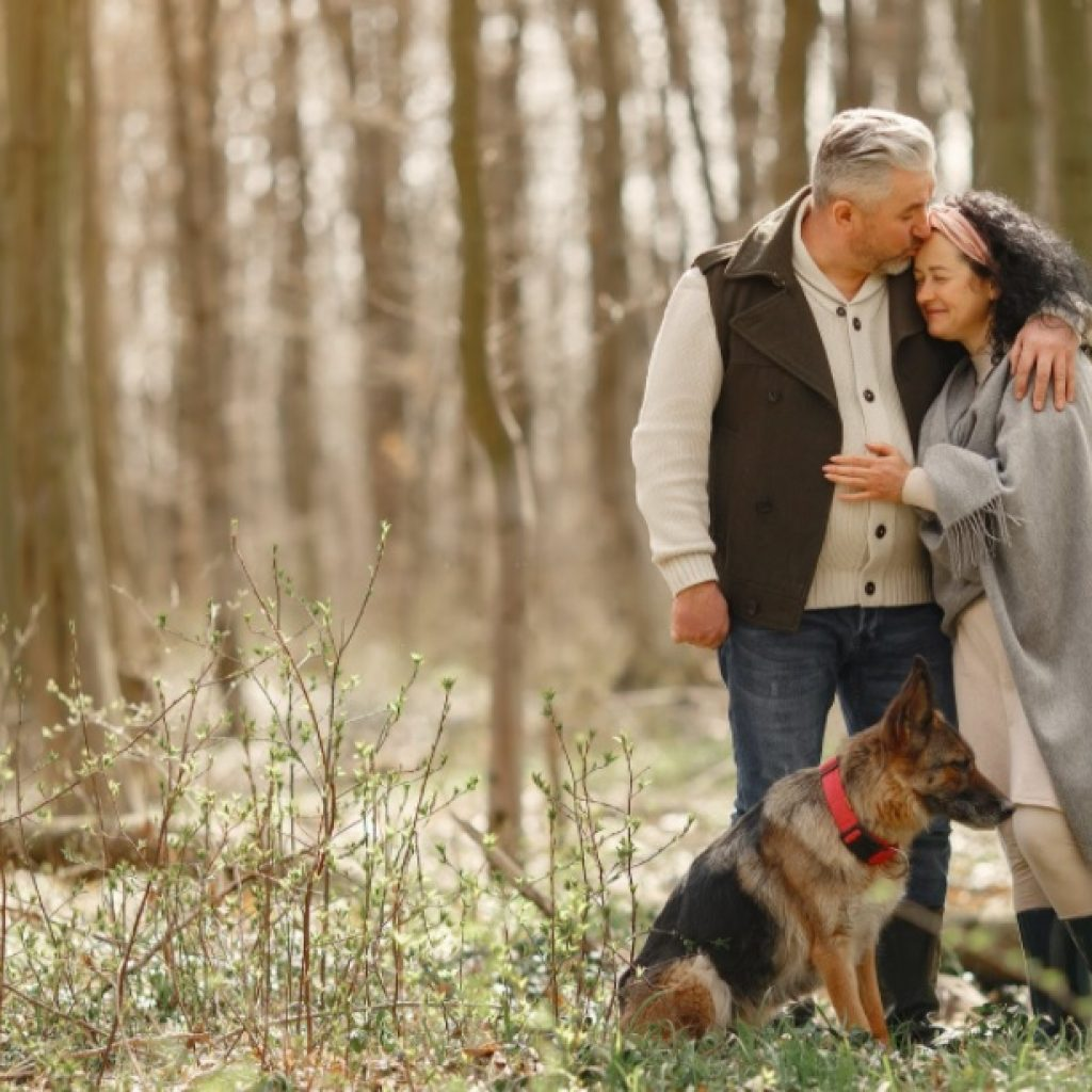 Senior couple in the woods during healthy retirement