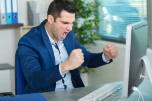 Man sacked for shouting 'come on' at computer screen