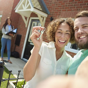 A couple with keys to a new house