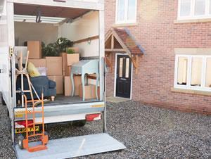 A moving van outside a house