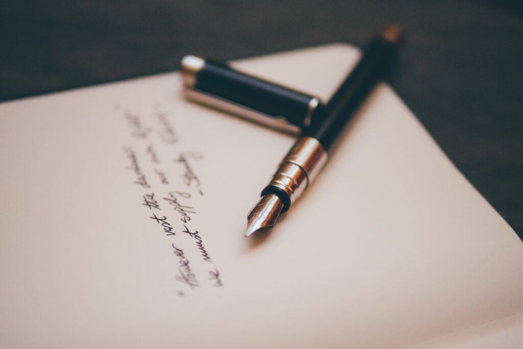A fountain pen with poetry written on WriteSome app