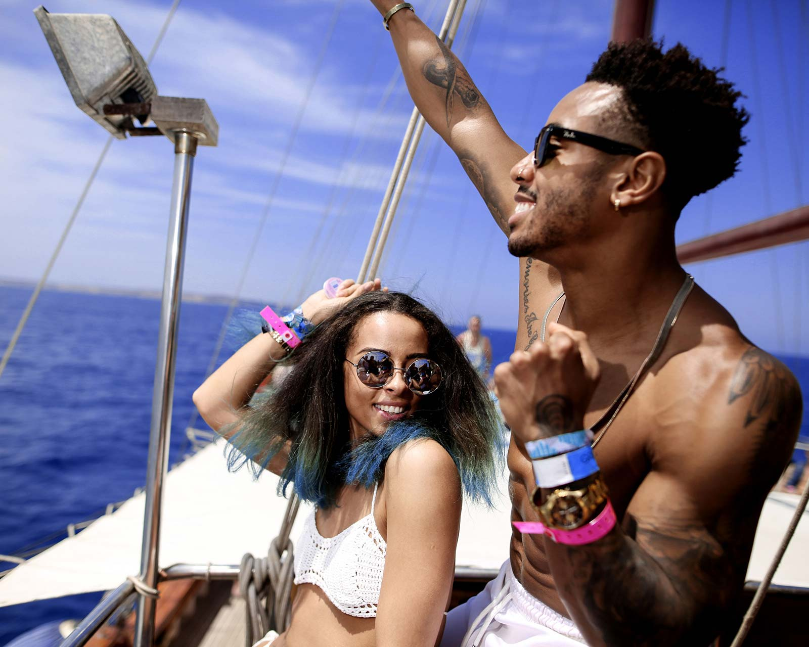 couple on a boat at a boat party off of the maltese coast experiencing disturbing malta festival