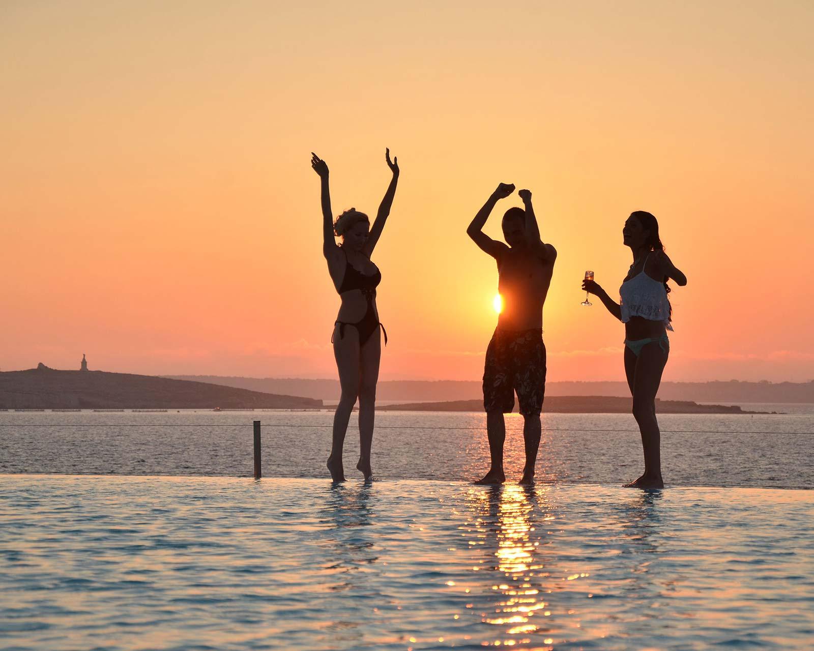 3 women enjoying a day time pool party at disturbing malta festival