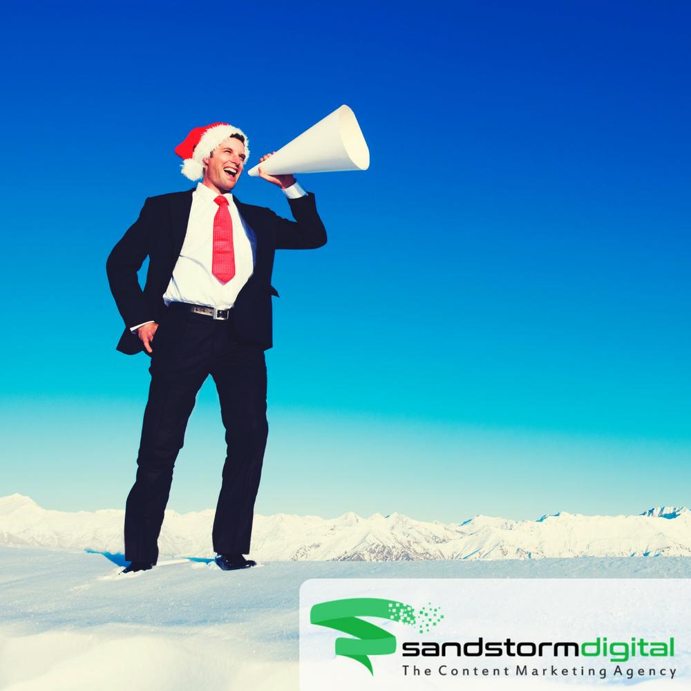 businessman with santa hat and megaphone