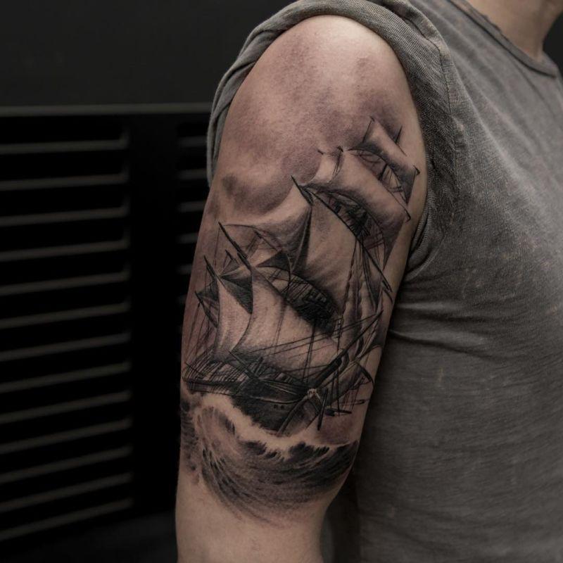 black and gray ship tatoo