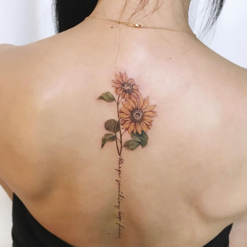 spine sunflower tattoo
