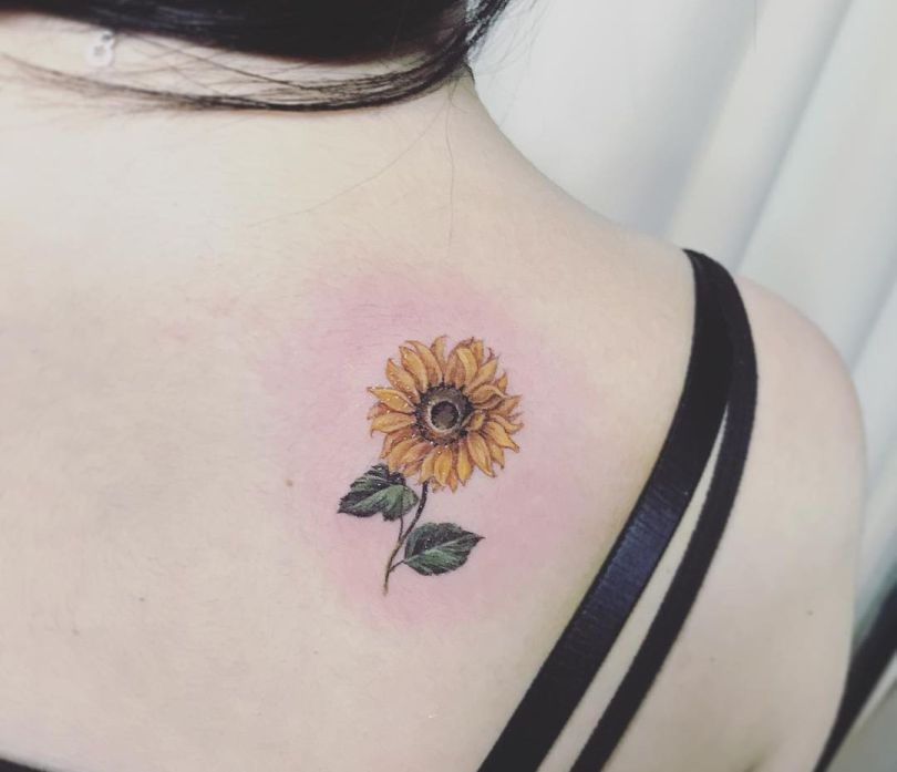 sunflower tattoo on back
