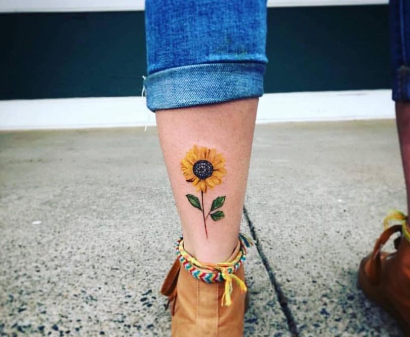 sunflower tattoo on leg