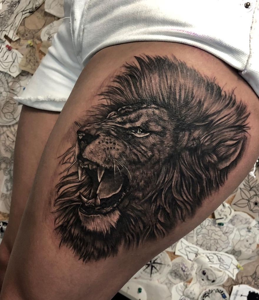 black and gray realistic lion tattoo