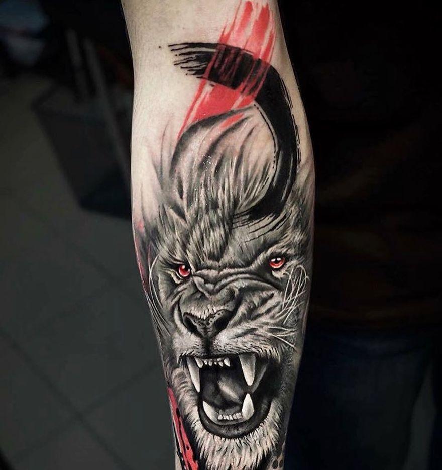 trash polka lion tattoo