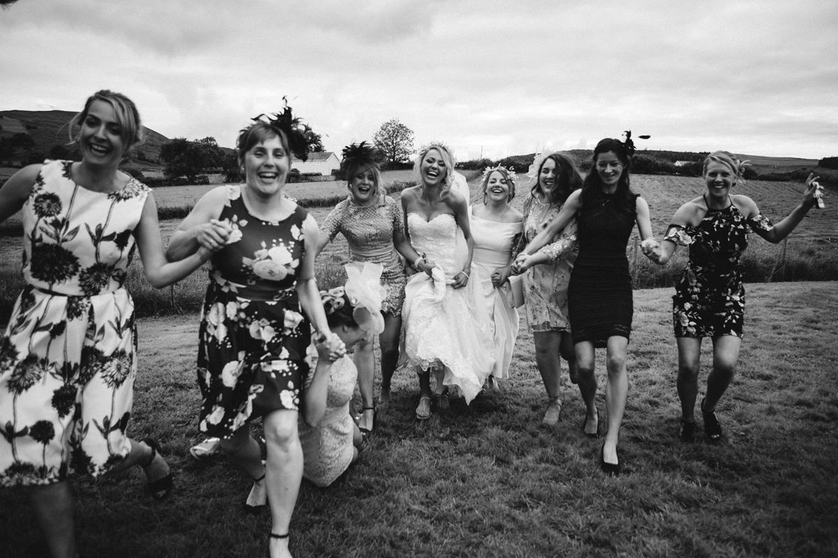 bridal party running