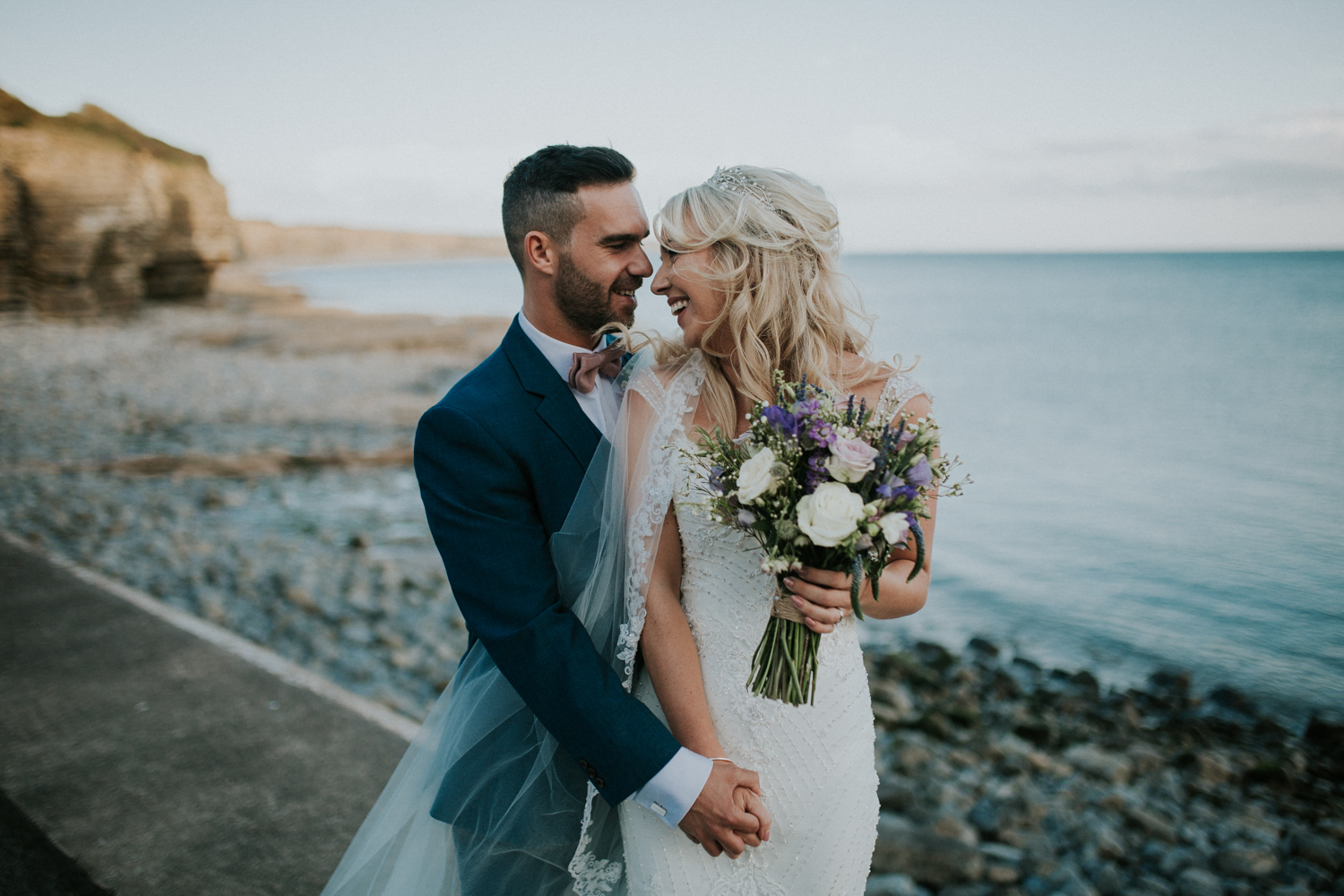 bride and groom portrait on the beach