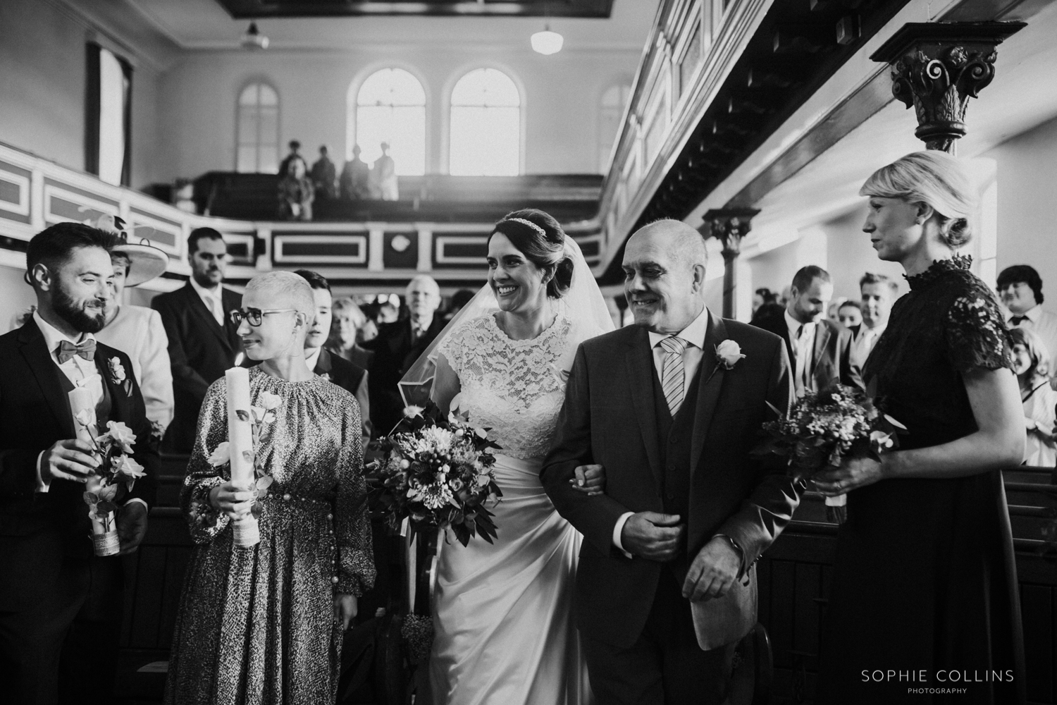 bride and dad walking down the isle