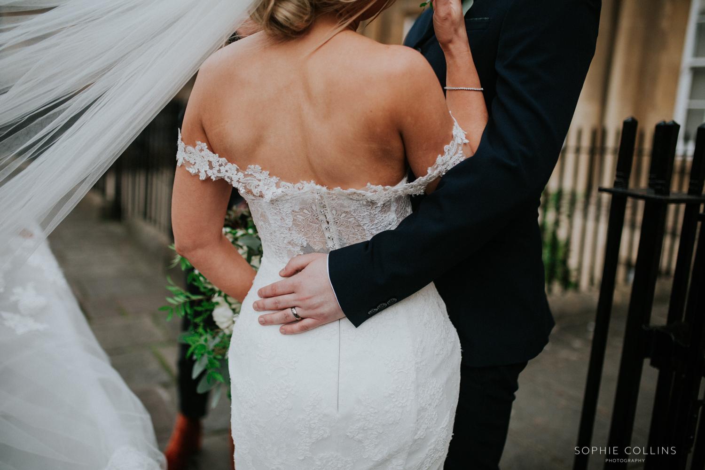 grooms hand around the bride