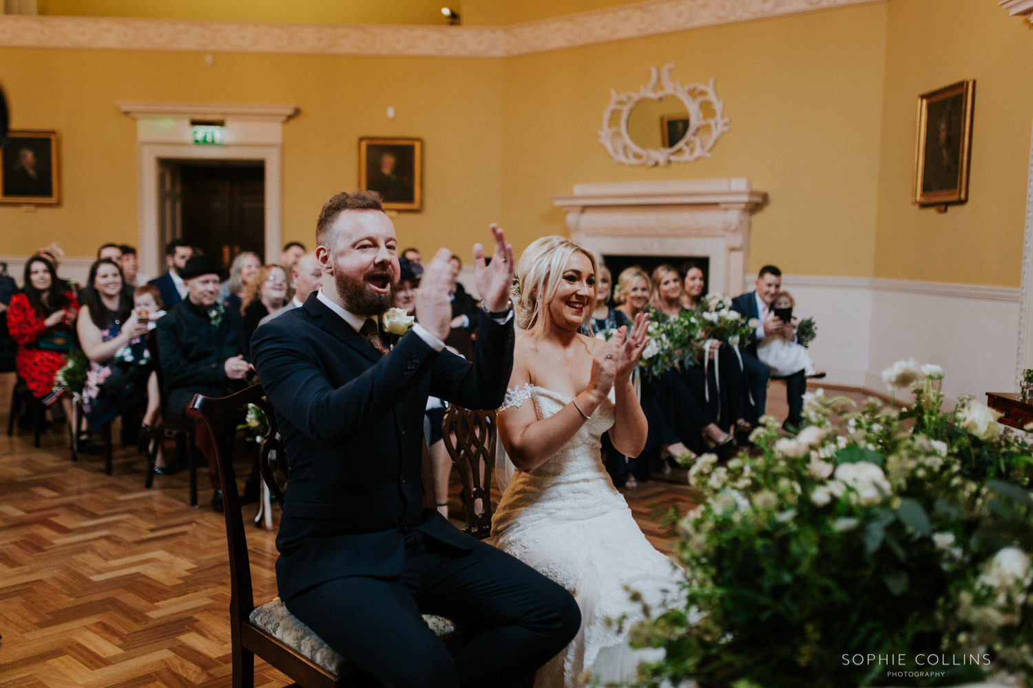 bride and groom clapping