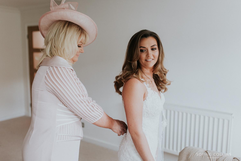 mam doing brides dress