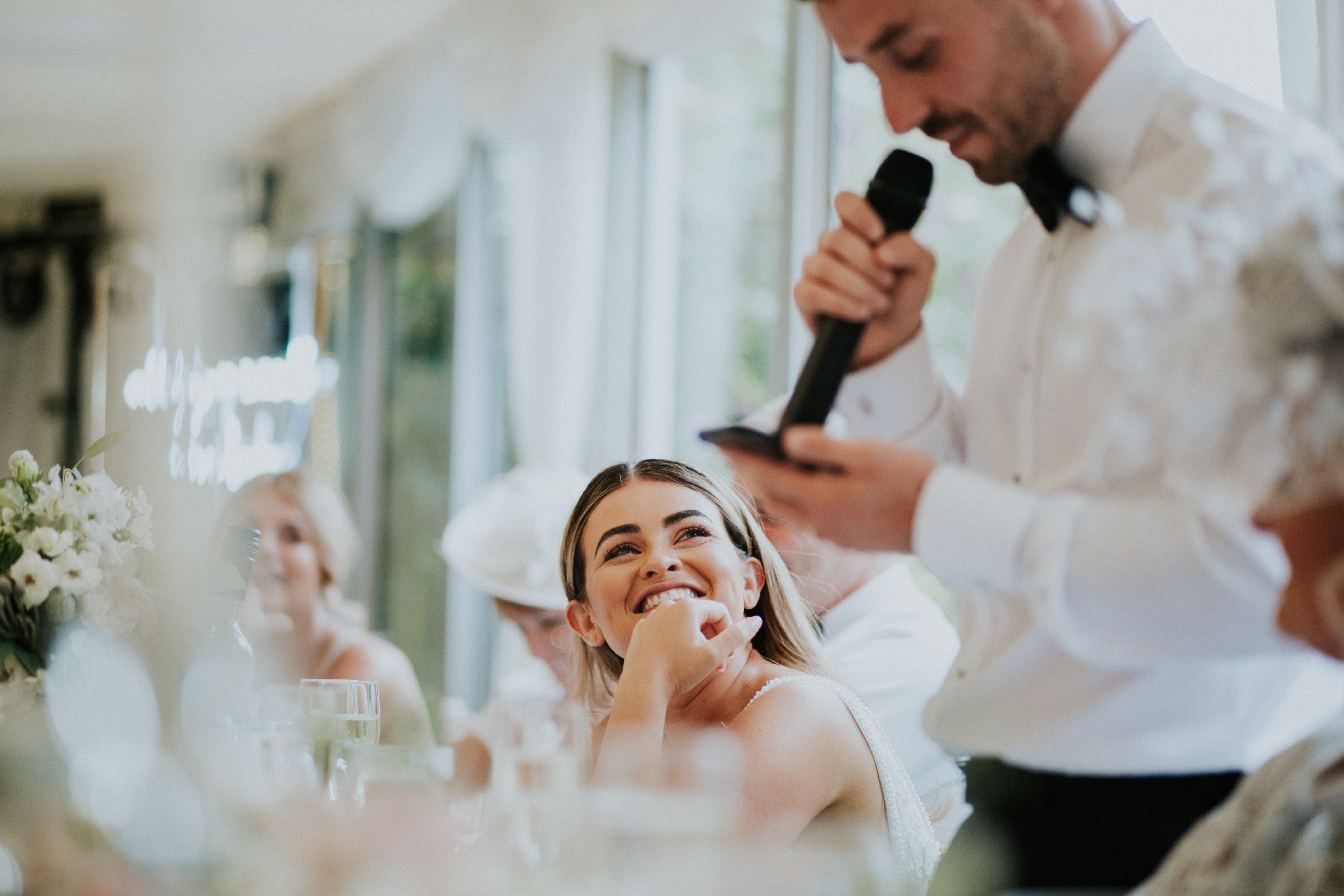 guests laughing at speeches