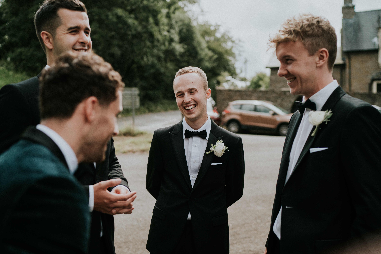 groomsmen smiling