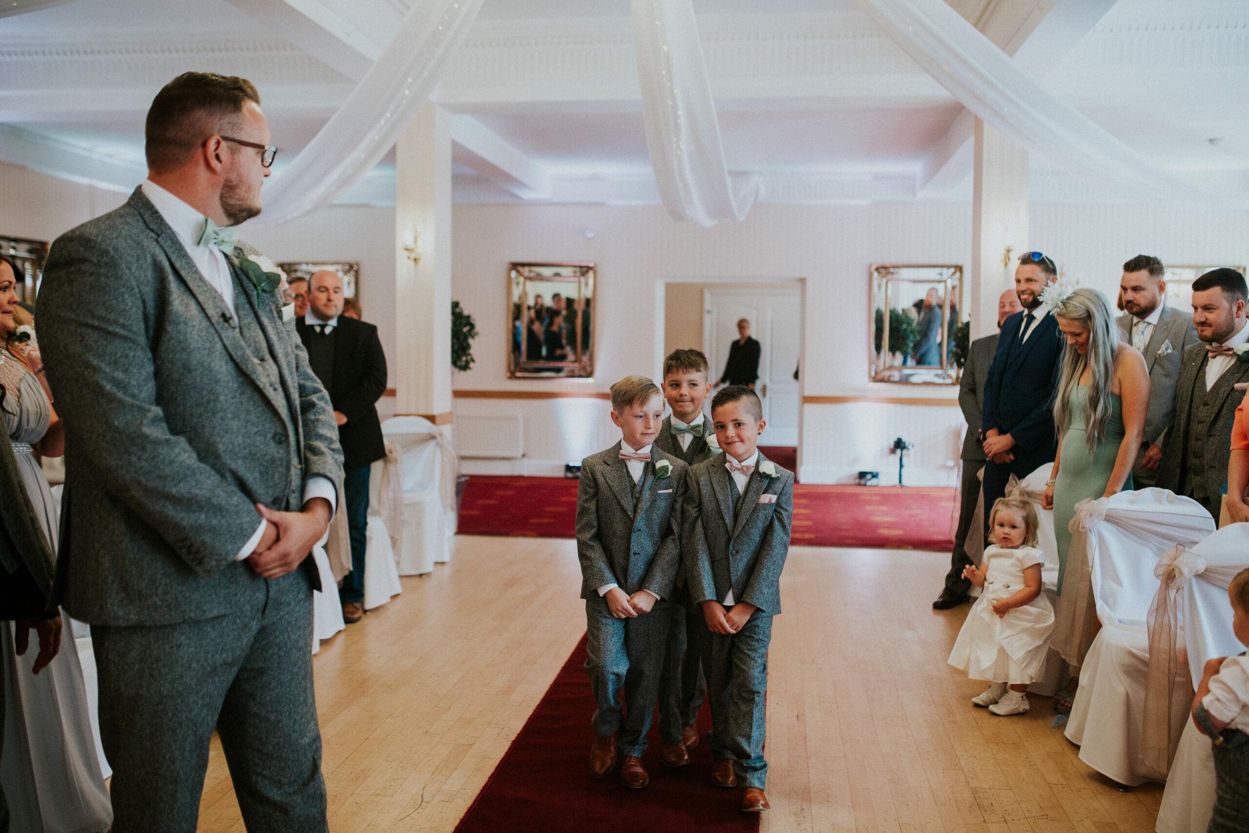 page boys walking down the aisle