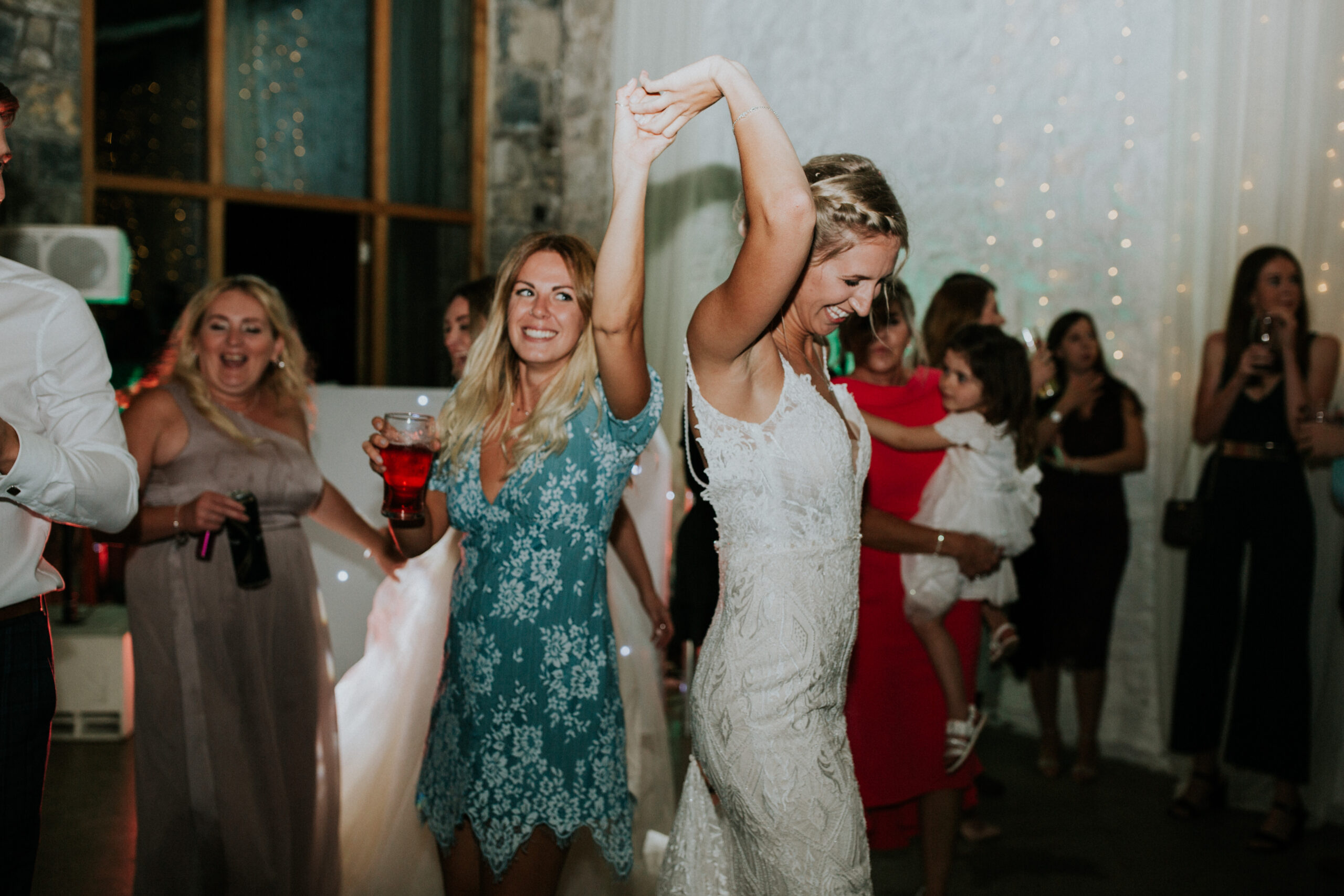 bride and her friend dancing