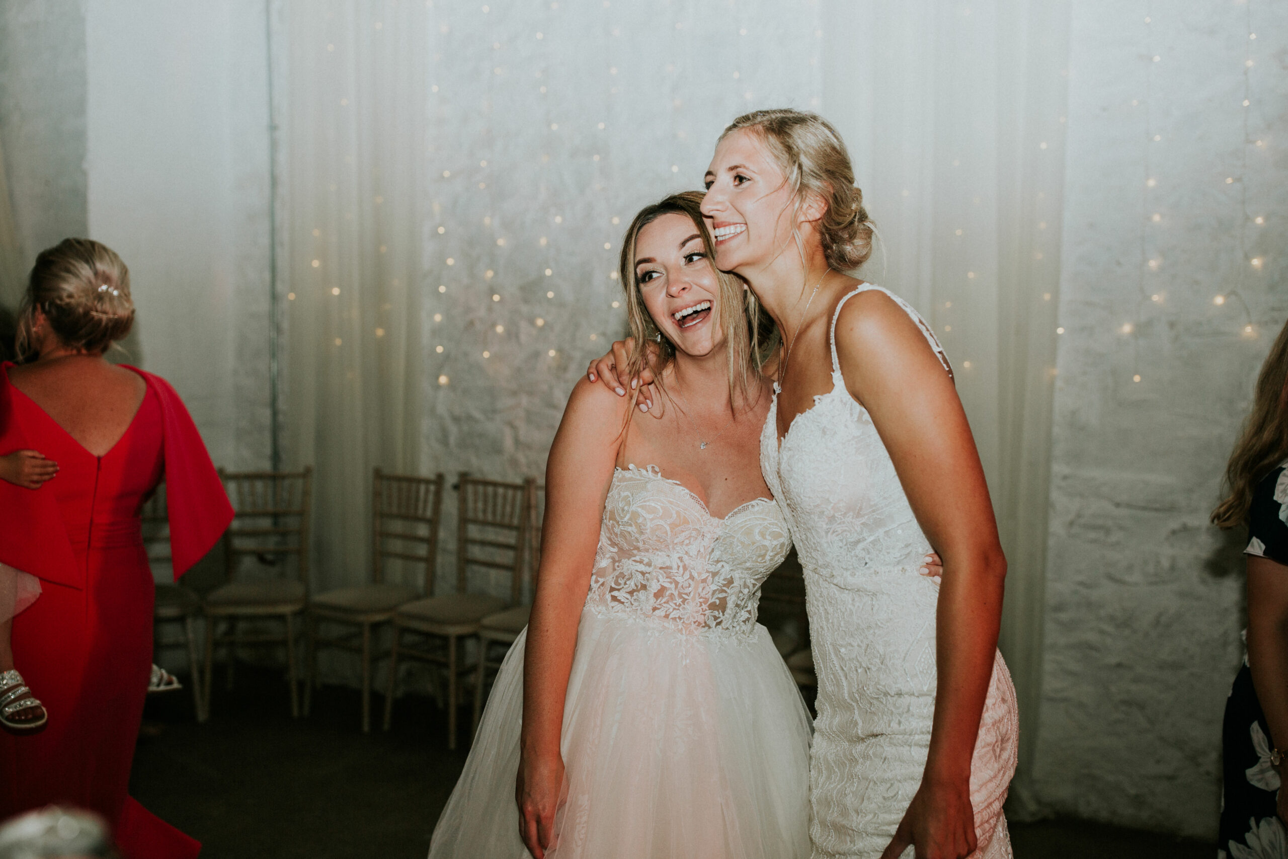 brides laughing on the dance floor