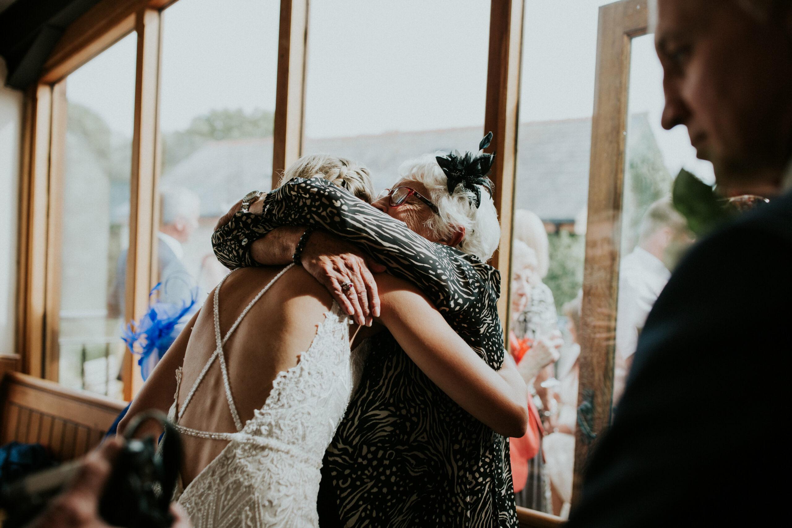guest hugging a bride