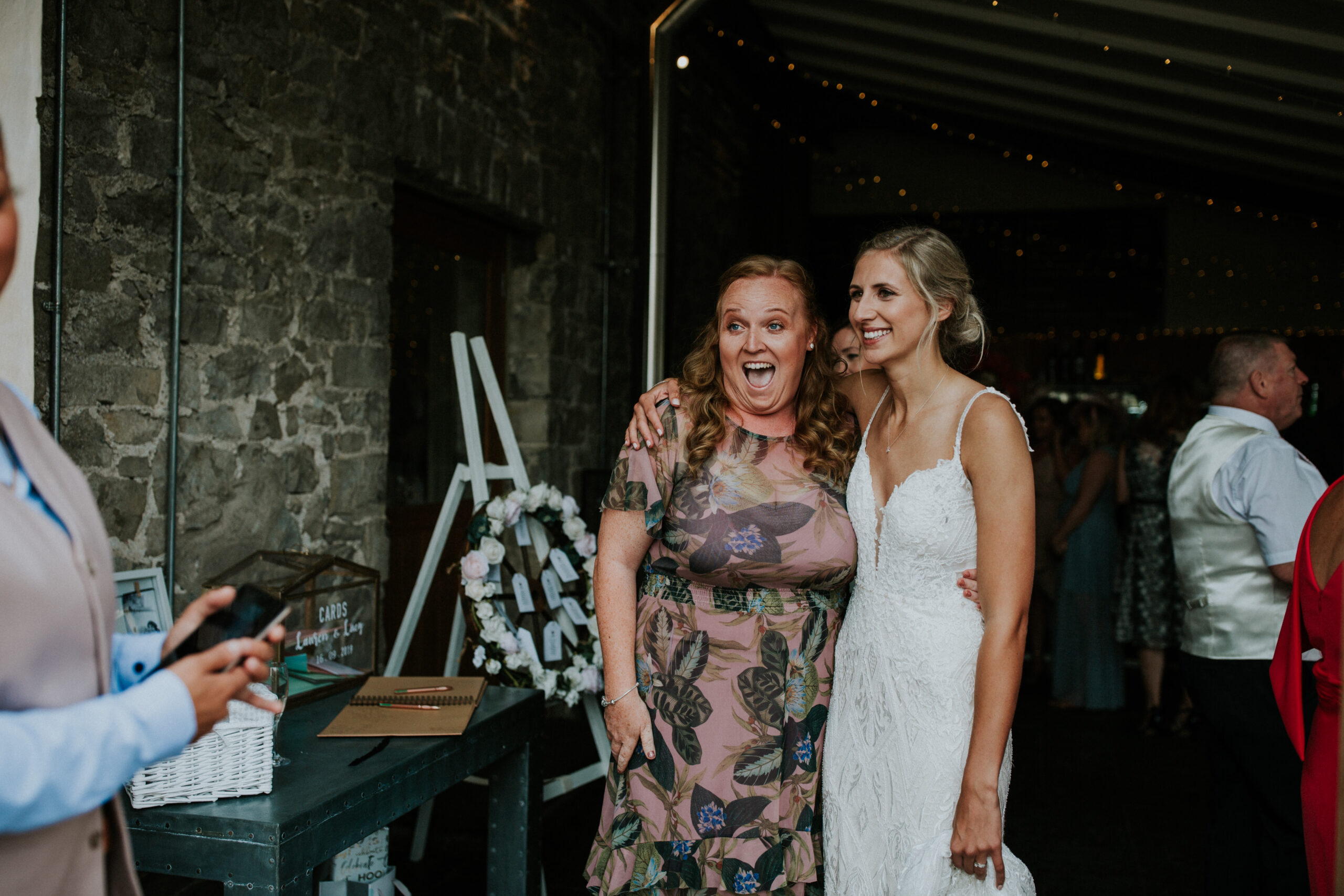 bride and her guest smiling