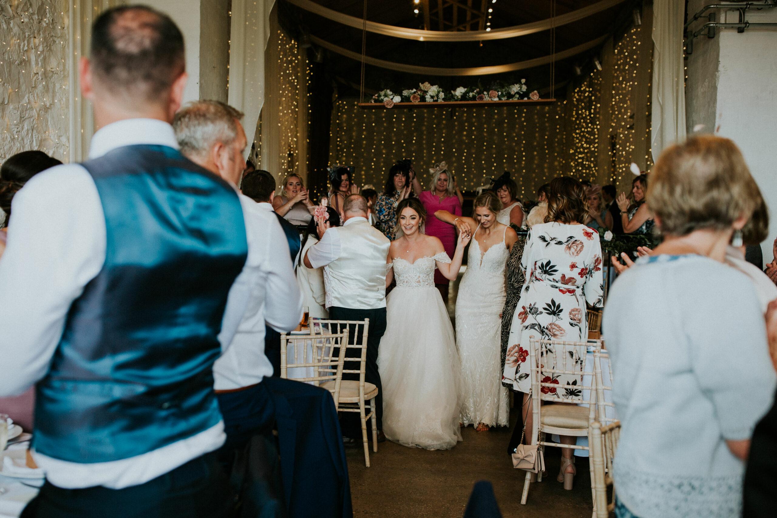 brides enter the reception