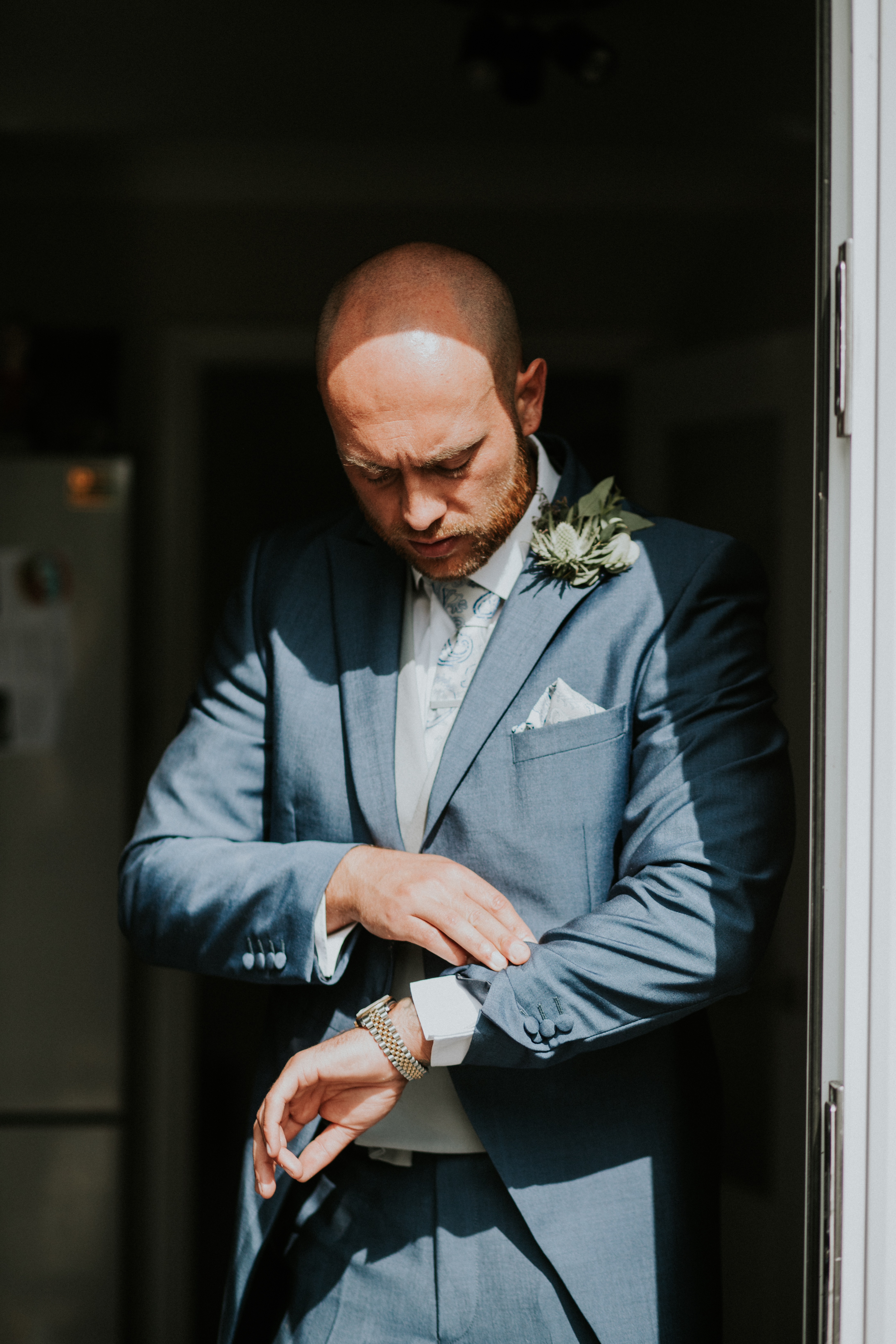 groom looking at his watch