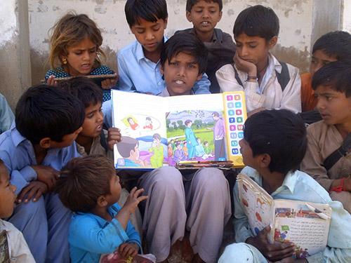 Children with Speaking Books.