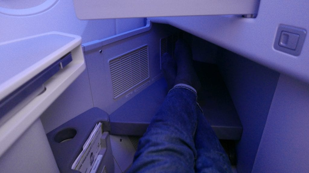 One downside to row 10 in the mini-cabin is that there is some kind of obstruction under the footrest, so there is no space for a carryon