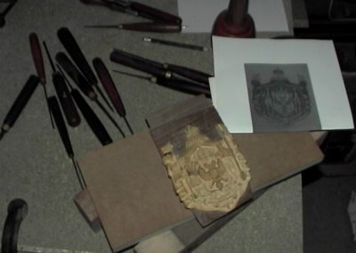 "Carving the Boxwood ""coat of Arms'' following the picture as reference .SASPOONER"