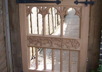 Gothic Oak gate showing the private side of the gate . note blacksmith ironmongery.  SASPOONER