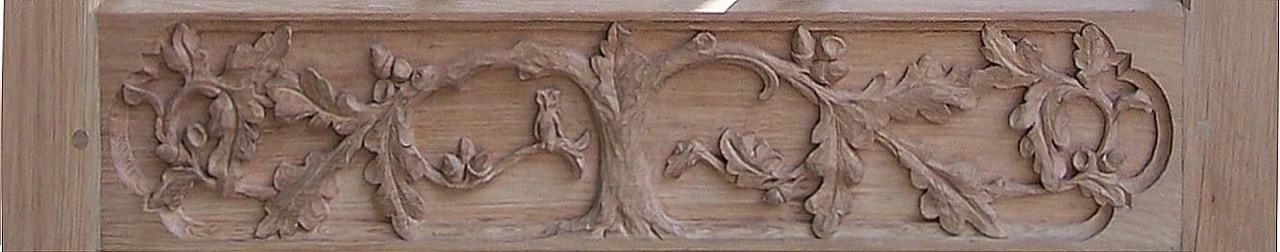 A close up of carved Oak leaf design , spot the Owl and mouse.  SASPOONER