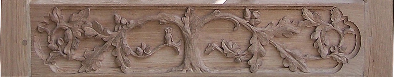 A close up of carved Oak leaf design , spot the Owl and mouse.  SASPOONER