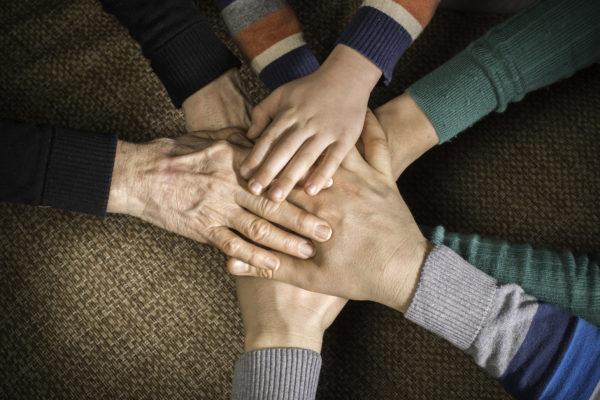 Many hands together. Interior shot