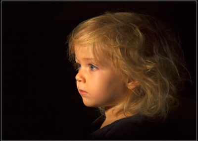 A child portrait taken with a single studio light.