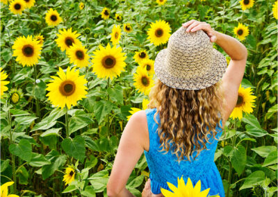 sunflower; yellow; flower; freedom; field; outdoor; people; countryside; happy; beauty; nature; summer; beautiful; smile; sun; model; pleasure; lifestyle; sunlight; landscape; young; attractive; sunny; dress; portrait; golden; happiness; fun; sunshine; health; life; wellness; emotion; summertime; dreams; person;