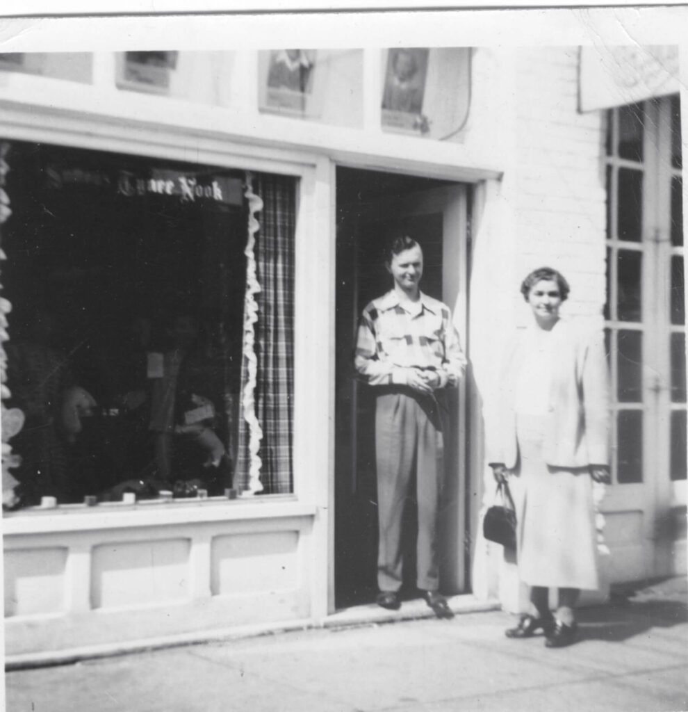 Joe E. Sutton with mother Ella (Guilkey) Sutton, first location of store, Sutton's Tynee Nook, N