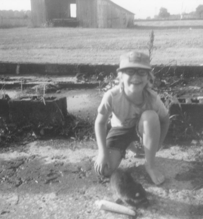 John Sutton as boy with pet raccoon