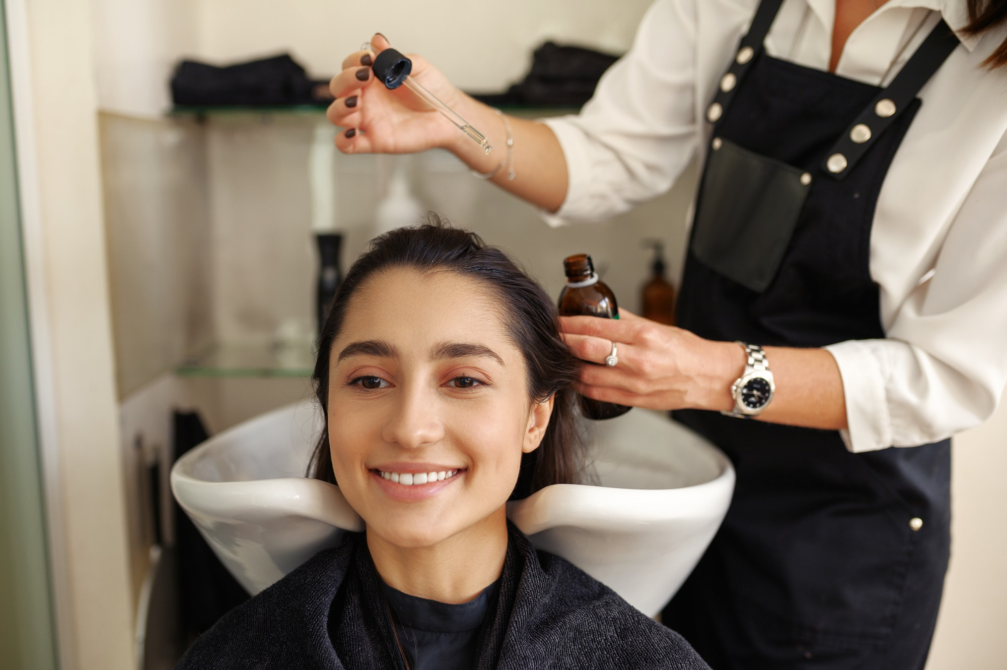 Hairdresser works with hair, hairdressing salon