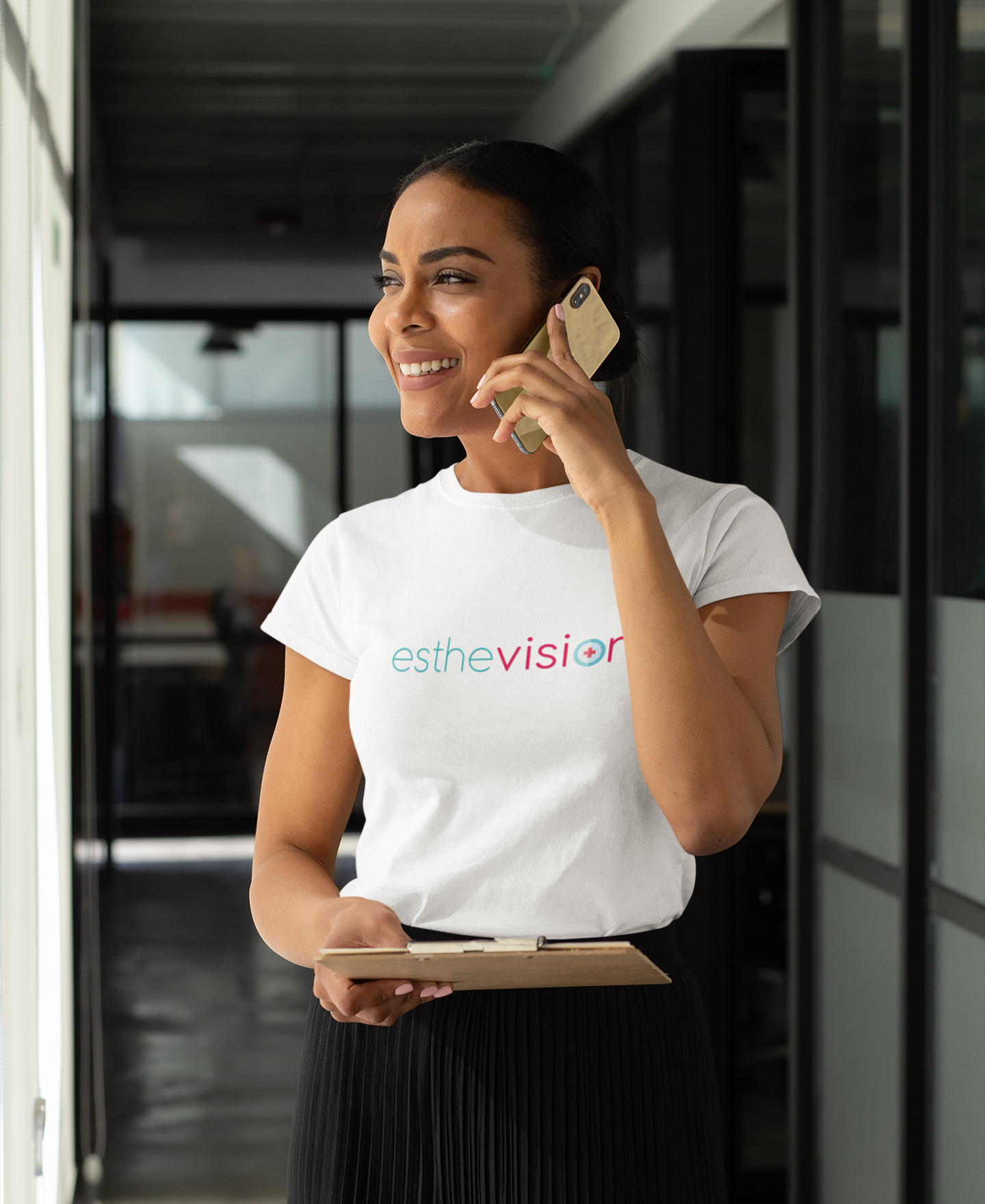 t-shirt-mockup-of-a-woman-speaking-on-the-phone-at-an-office-hallway-31700-(1)