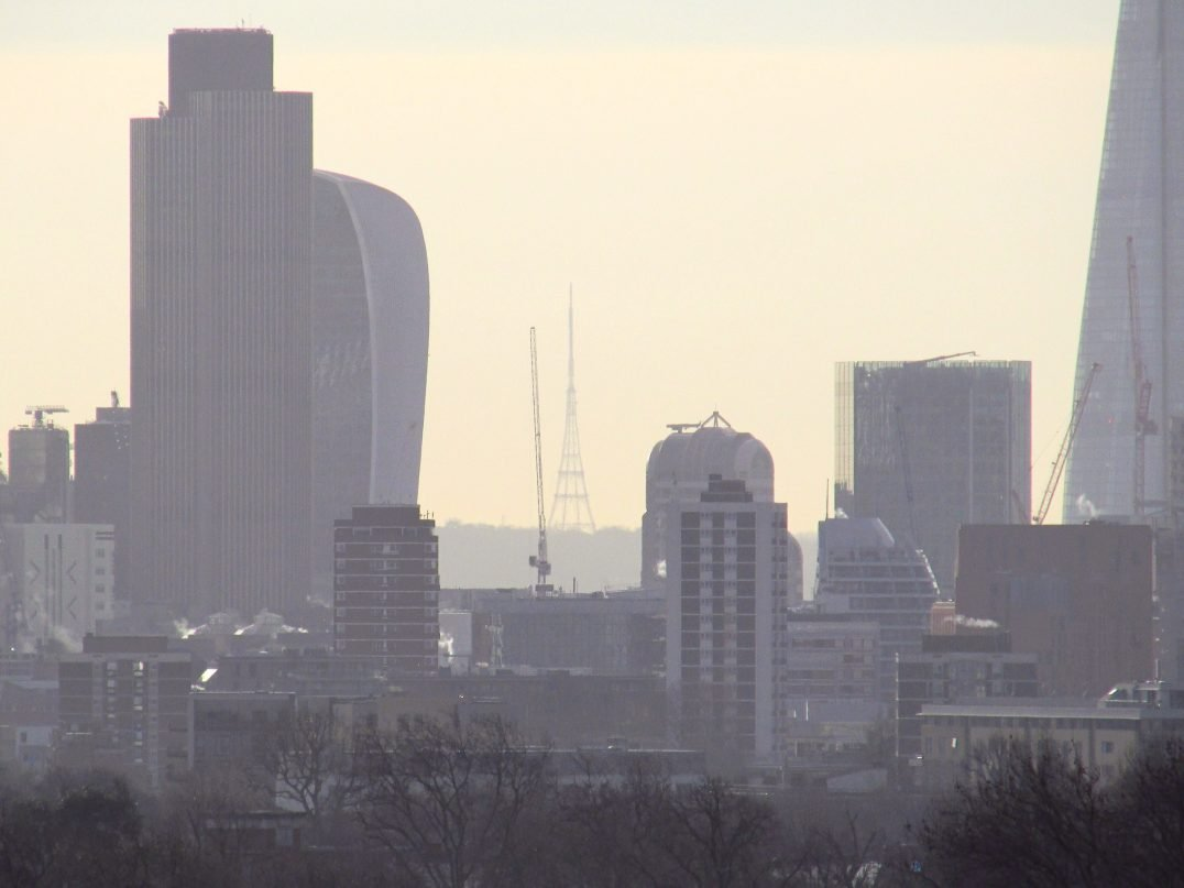 Air pollution sits over London, with several tall buildings silouhetted
