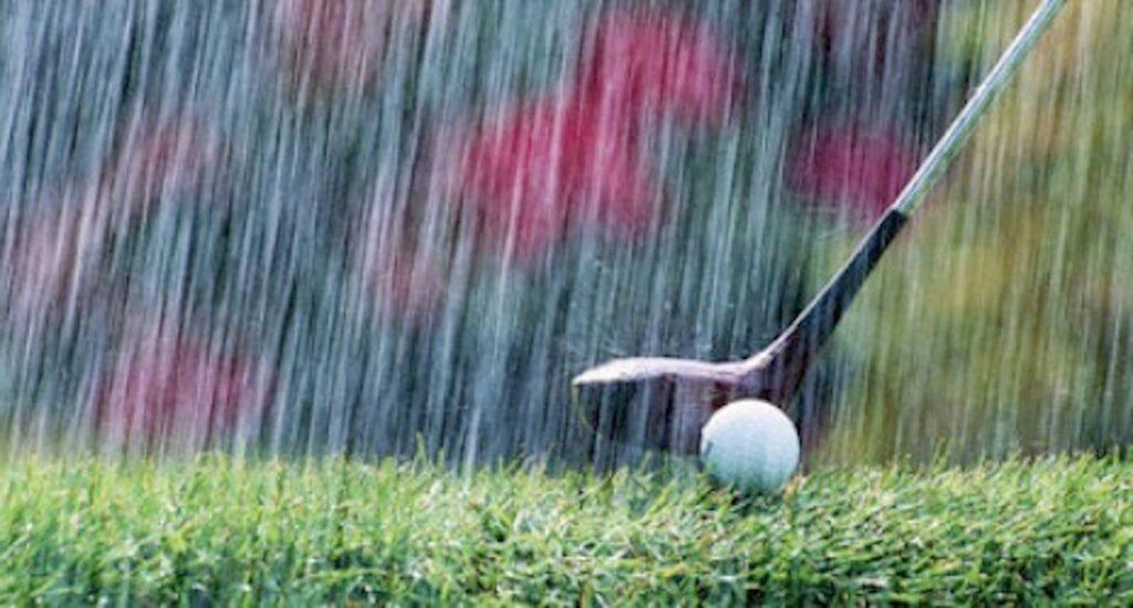 Golf shot in rain golf gloves