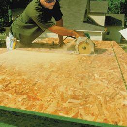 Man Cutting Plywood & OSB   Construx Building