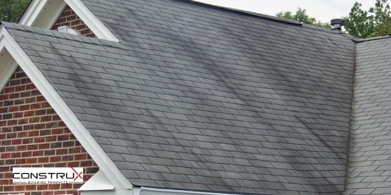 The appearance of dark patches on your roof